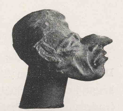 Photograph of a sculpture of a head with an elongated face.